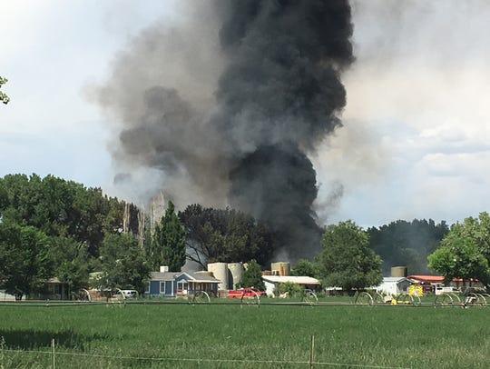 Firefighters battle a blaze in an industrial yard east