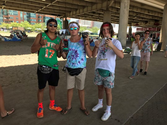 Michael Song (left), Matthew Dentinger (center) and Bowen Daniel (right), all 16, hold up accessories. July 16, 2017