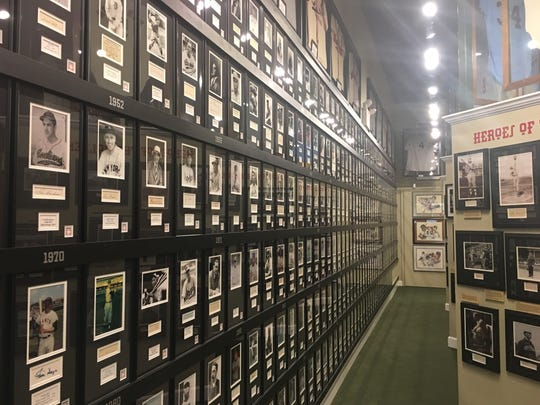 One of the most prominent displays at the Green Diamond Gallery in Montgomery, Ohio, features a photo for every inductee into the National Baseball Hall of Fame. Most of the photos are signed and organized by year of induction.