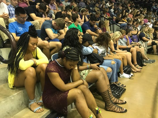 In late August 2017, Abilene Christian University students prayed for Hurricane Harvey victims during chapel in Moody Coliseum. Chapel has been reworked but continues online for students this semester.