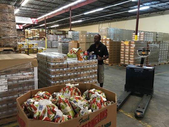 Walter Daniels of the Harry Chapin Food Bank warehouse