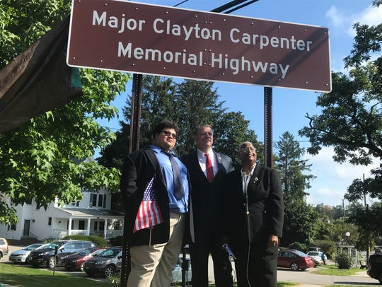 Army Capt. Clayton Carpenter's brother, Christian (left),