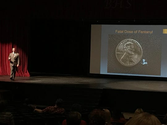 Neil Morgenstern of Appalachia HIDTA shows a slide depicting a lethal dose of the drug fentanyl to the audience at an opioid abuse prevention event Sept. 28 at Bearden High School.