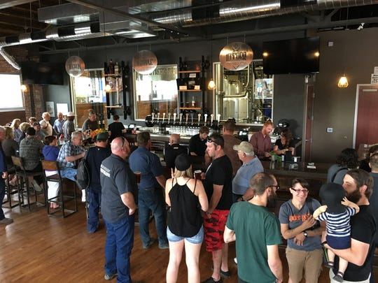 The Mill Street Still and Brew bar room filled up during its soft opening June 7, 2017.