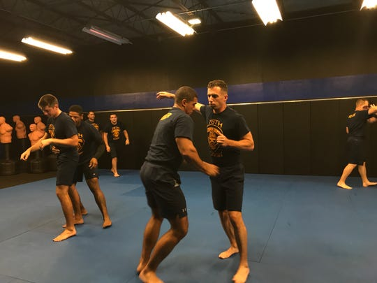 Cadets of the 76th Corpus Christi Police Academy practice defensive tactics during training taught by a Jiu-Jitsu instructor Thursday, Oct. 5, 2017, at the police academy.
