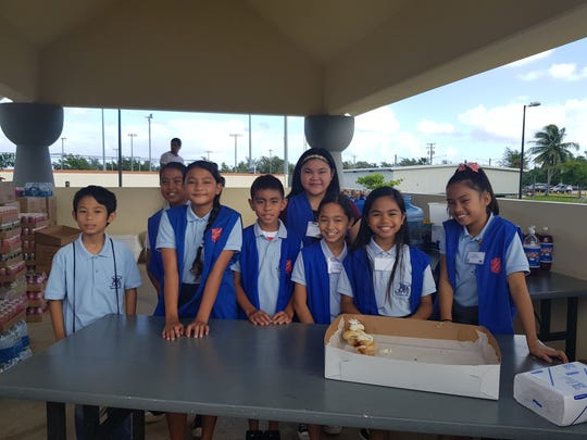 Members of the Juan M. Guerrero Elementary School National Elementary Honor Society (NEHS) volunteered their time to help serve refreshments during the Thanksgiving Meal at the Chamorro Village on Nov. 23. Pictured from left: Caerwyn, Tambora, Eyana Duenas, JaynaRose Cruz, Ethan Manlangit, Juliana Lagman, Jessani Leon Guerrero, Ella Escalera, Ariana Tolentino.