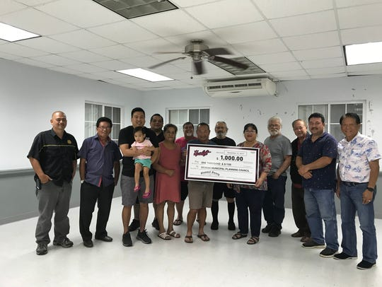 On Dec. 12 Upshift Ent. presented a $1,000 check to