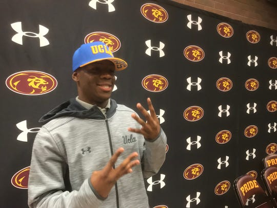 Kenny Churchwell holds up four fingers as he sports a UCLA hat on Friday, Jan. 26, 2018 at Mountain Pointe High School.