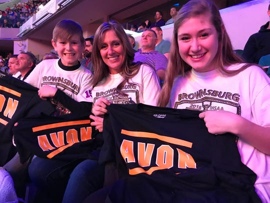 Some Brownsburg fans throw on Avon shirts when Garcia takes the mat.
