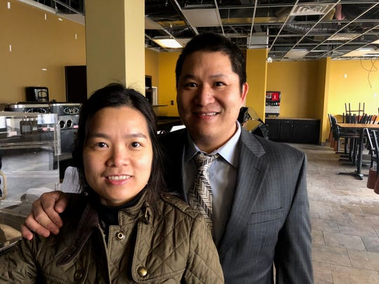 En (Denny) Xie, right, owns Samurai Steak House, which is soon to open a location in downtown Farmington. He's pictured with his wife, Minjuan Zheng, in the space on Grand River Avenue a few blocks east of Farmington Road, pre-construction April 3, 2018.