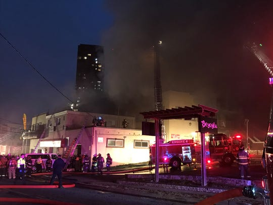 Firefighters respond to a four-alarm blaze on Old River