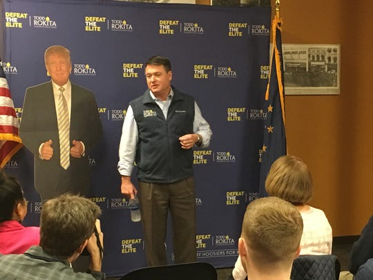 Rep. Todd Rokita campaigns with a cardboard cutout of President Trump in South Bend, Ind.