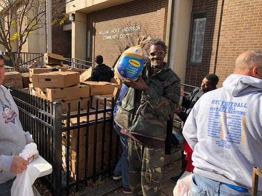 "A man holds up a turkey he received last fall at the Mariano Rivera Foundation event at Wilmington's William ""Hicks"" Anderson Community Center."