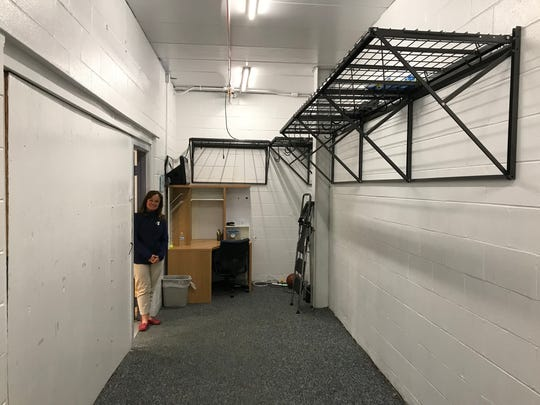 YMCA of Gloucester County's CEO Melissa O'Neill Walczak stands in a room that will become the home of Woodbury Police's Community Policing Division, April 19, 2018.