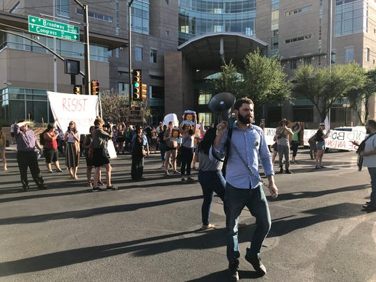 """Protesters blocked off an intersection in front of Tucson's federal courthouse on Monday to rally against a """"not guilty"""" verdict in the slaying of an unarmed Mexican teenager at the hands of a Border Patrol agent."""