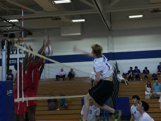 Millburn's Spencer Estes strikes the ball for the Millers in a two set victory over Shabazz.