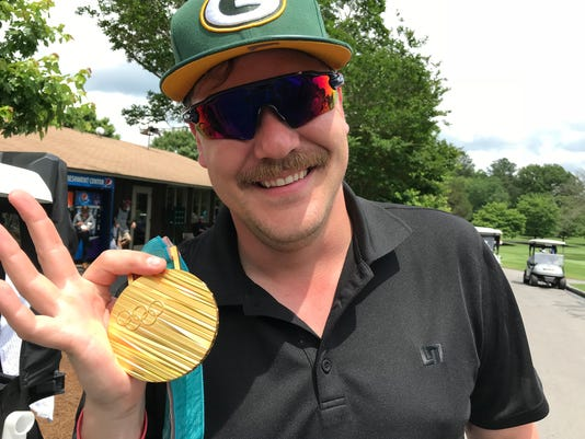 Olympic gold medalist Matt Hamilton holds his curling gold medal during the second day of action in the BMW Charity Pro-Am Friday, May 18, 2018 at Furman University.