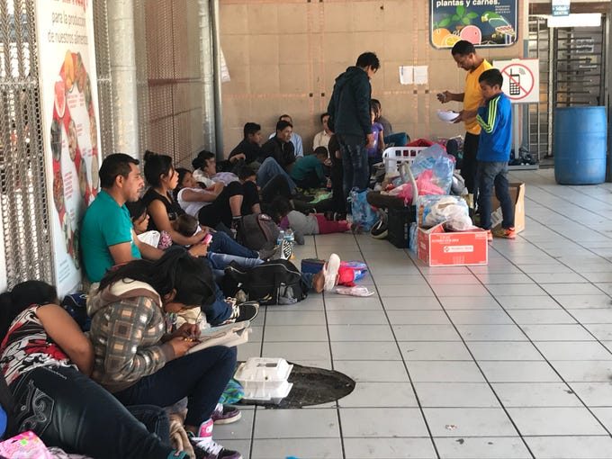 More than 50 migrants, mostly from Guatemala, wait