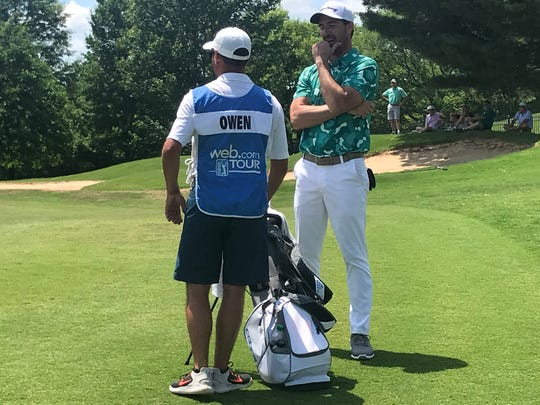 Country music artist Jake Owen chats with his caddie