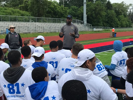 Calvin Johnson speaks at his camp at Southfield high school outside Detroit on June 2, 2018.