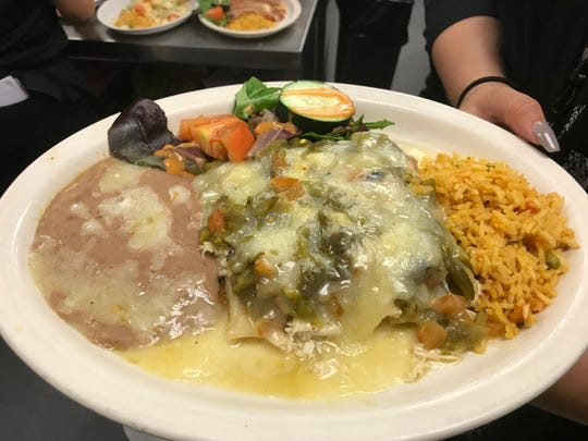 L&J Cafe, at 3622 E. Missouri Ave., is always busy for lunch and dinner. Among the popular plates are the green chile chicken enchiladas.