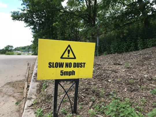 One of several signs asking trucks to slow down on