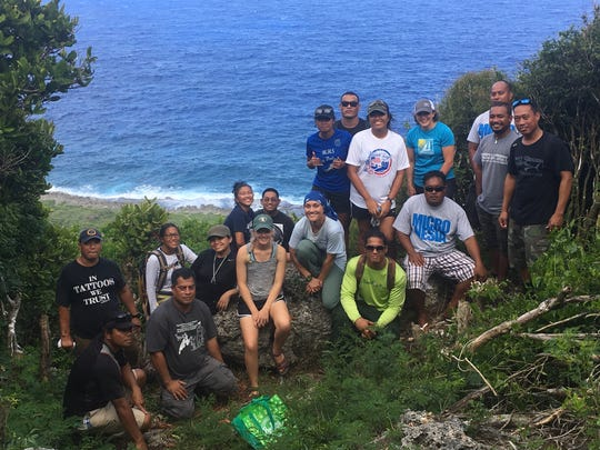 """Participants and instructors of the """"Tropical Forest Ecology"""" course pose for a photo on the East Coast of Guam. The 17-day course was offered by the University of Guam in partnership with Iowa State University and the U.S. Forest Service from May 21 to June 7."""
