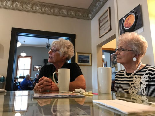 JoAnn Johnson and Sadie Lippert talk politics at Wake Cup, a trendy coffee shop in historic Fort Benton, Montana. They're unimpressed with President Donald Trump.