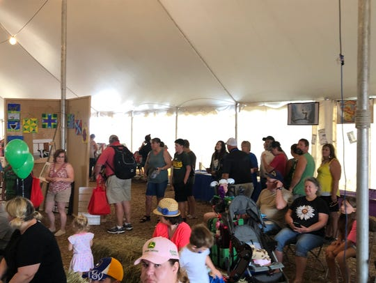 A steady crowd waits in line to meet Green Bay Packer Linebacker Vince Biegel at Farm Technology days on July 12, where he spoke about his experiences growing up on a cranberry marsh in Wisconsin Rapids.