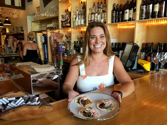"Cara Graham co-owner of Lockeland Table shows off the ""community hour"" tacos."