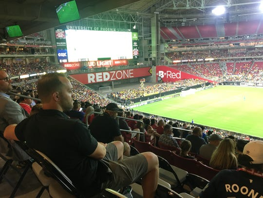 Phoenix Rising GM Bobby Dulle watches with his young