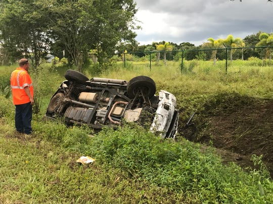 A car flipped in a ditch off 85th Street in Indian River County on Wednesday, July 25, 2018.