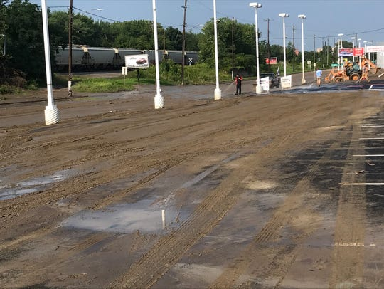 Mud caked the parking lot of Jack Sherman Toyota on