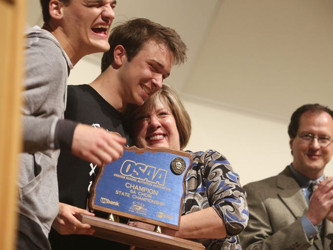 South Salem High School director Carol Stenson celebrates with students after the choir won the OSAA 2014 6A Choir State Championships at George Fox University Saturday, May 10, 2014.
