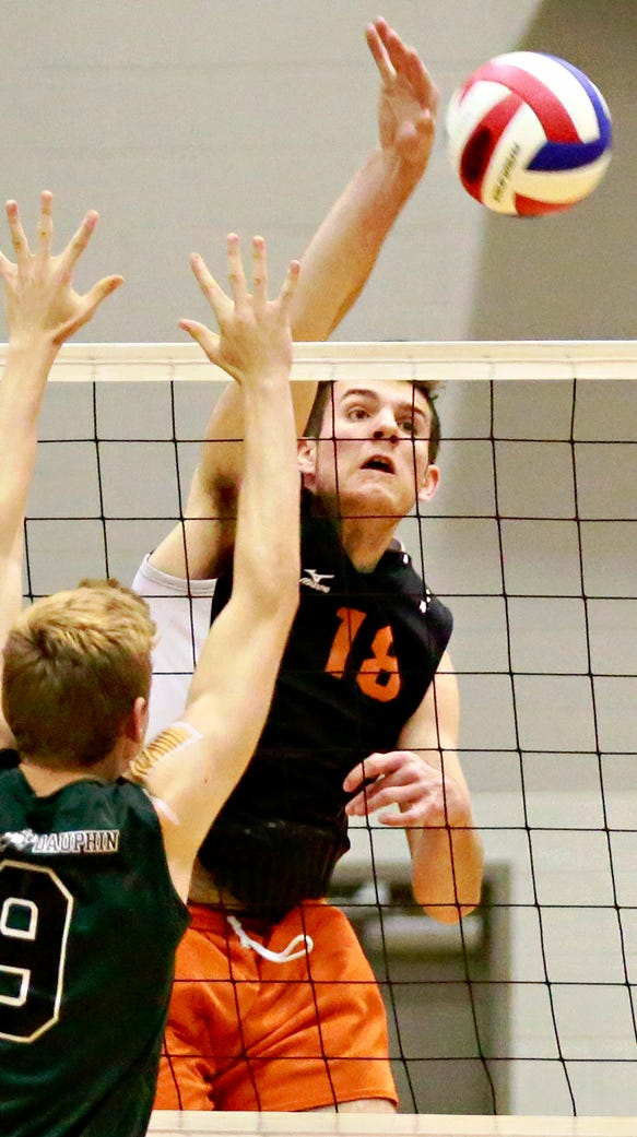 Central York's Cole Johnson, center, earned all-state