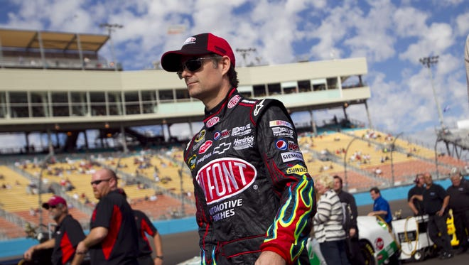 NASCAR driver Jeff Gordon walks to his car for qualifying for the NASCAR Sprint Cup Series at the Phoenix International Raceway in Avondale on Saturday, November 12, 2011.