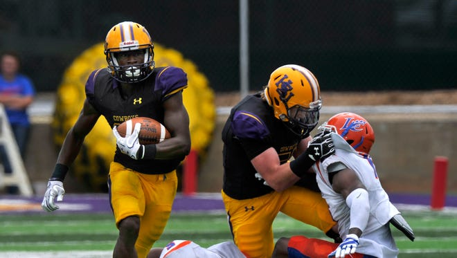 Hardin-Simmons University running back Jaquan Hemphill carries the ball as a teammate cleans-up the defense behind him during Saturday's game against Louisiana College Sept, 16, 2017.