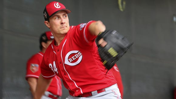 Cincinnati Reds starting pitcher Homer Bailey (34) delivers in the bullpen, Sunday, Feb. 18, 2018, at the Cincinnati Reds Spring Training facility in Goodyear, Arizona.