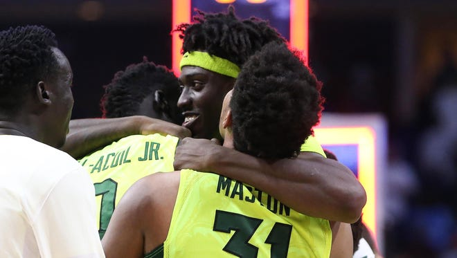 Baylor forward Johnathan Motley embraces teammates after the Bears topped USC to clinch a trip to the Sweet 16.