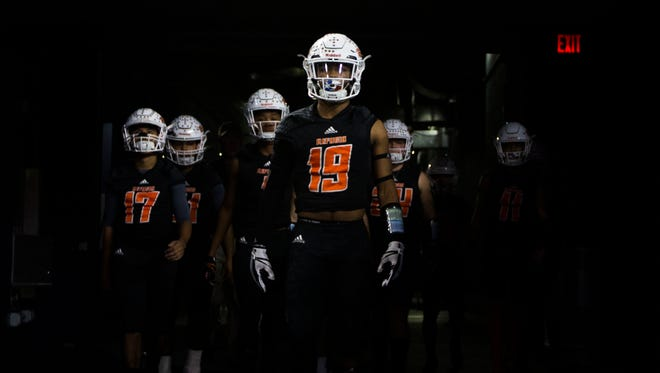 Refugio's players take the field before the Class 2A Division I state championship game Wednesday, Dec. 22, 2017, at the AT&T Stadium in Arlington.