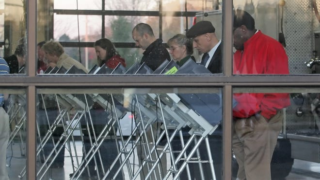 Tippecanoe County residents cast ballots at vote centers, not precincts, as other counties. There are 19 vote centers, including Lafayette Fire Station No. 5, where this 2010 file photo was taken.