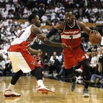 Washington Wizards guard John Wall (2) moves past Toronto Raptors forward Terence Ross (31) in the fourth quarter in game two of the first round of the NBA Playoffs at Air Canada Centre. Wizards beat raptors 117 - 106.