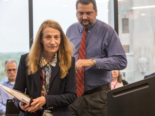 Macomb County Clerk Karen Spranger leaves a hearing last year in Mt. Clemens with her attorney Frank Cusumano Jr., who is defending her in a do-or-die court case that began Monday in Port Huron -- and which could end with the county ousting the neophyte Republican Spranger.