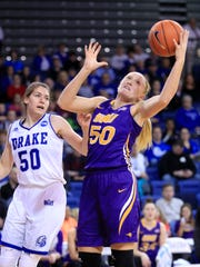 Megan Maahs of UNI comes down with a rebound as Sara Rhine of Drake defends Friday, Jan. 19, 2018 in Des Moines.