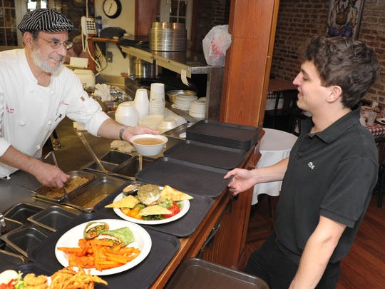In this Advertiser file photo, Opelousas native Paul Miller, left, executive chef at K-Paul's in New Orleans, returned home for the annual Soiree Royale. This year, chef Marty Cosgrove, director of catering and special events of K-Paul's, will also return home as a judge of the event.