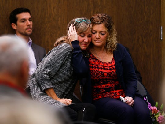 Mary Jane Holmes (left) and Julie Oziah-Gideon embrace each other after they spoke about their challenges to get mental health and substance abuse help for their kids on Friday, Nov. 17, 2017. The two spoke at a press conference where the Springfield-Greene County Health Department and other community partners announced that they have hired consultants to conduct an assessment about mental health and substance abuse.