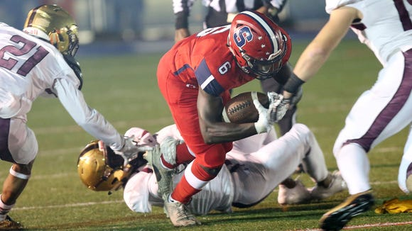 37c8a4804 Stepinac s Atrilleon Williams (6) looks for some running