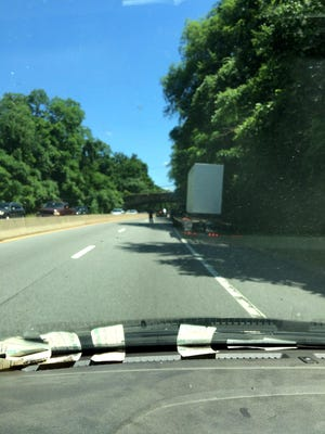 State Police Investigator John Alfala stopped traffic Wednesday afternoon so a truck could get off the Hutchinson River Parkway before hitting the Wilmot Road overpass.