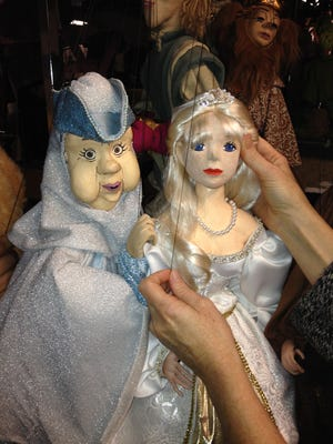 The beautiful Tom Tichenor marionettes — including Cinderella and her fairy Godmother — will perform for free at the Main Library on Friday and Saturday.