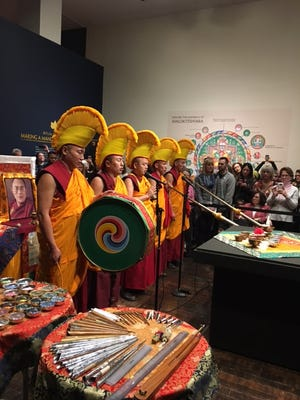 Opening ceremony of the sand mandala construction at the Frist Center for the Visual Arts.
